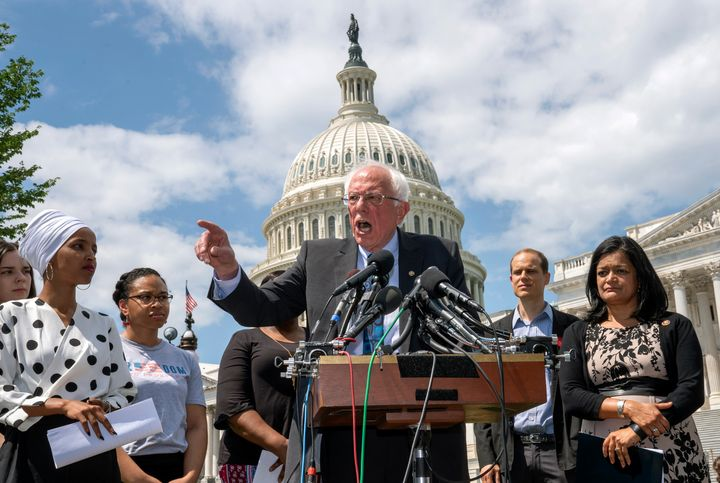 Democratic presidential candidate Bernie Sanders, flanked Monday by Rep. Ilhan Omar (D-Minn.), left, and Rep. Pramila Jayapal