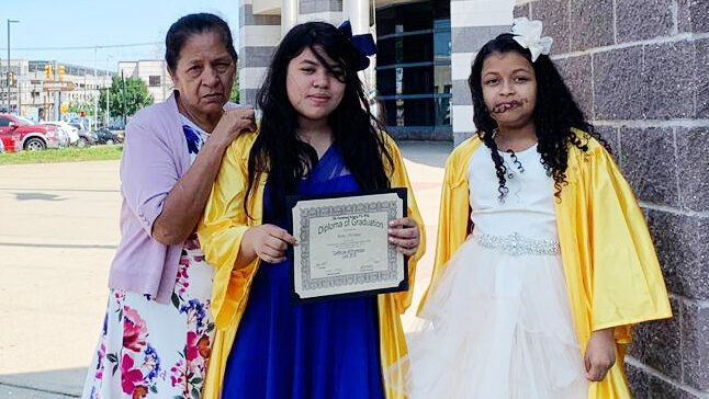 Alma Sofia Centeno Santiago's mother and 11-year-old daughter, center, at her fifth-grade graduation, along with one of the daughter's friends.