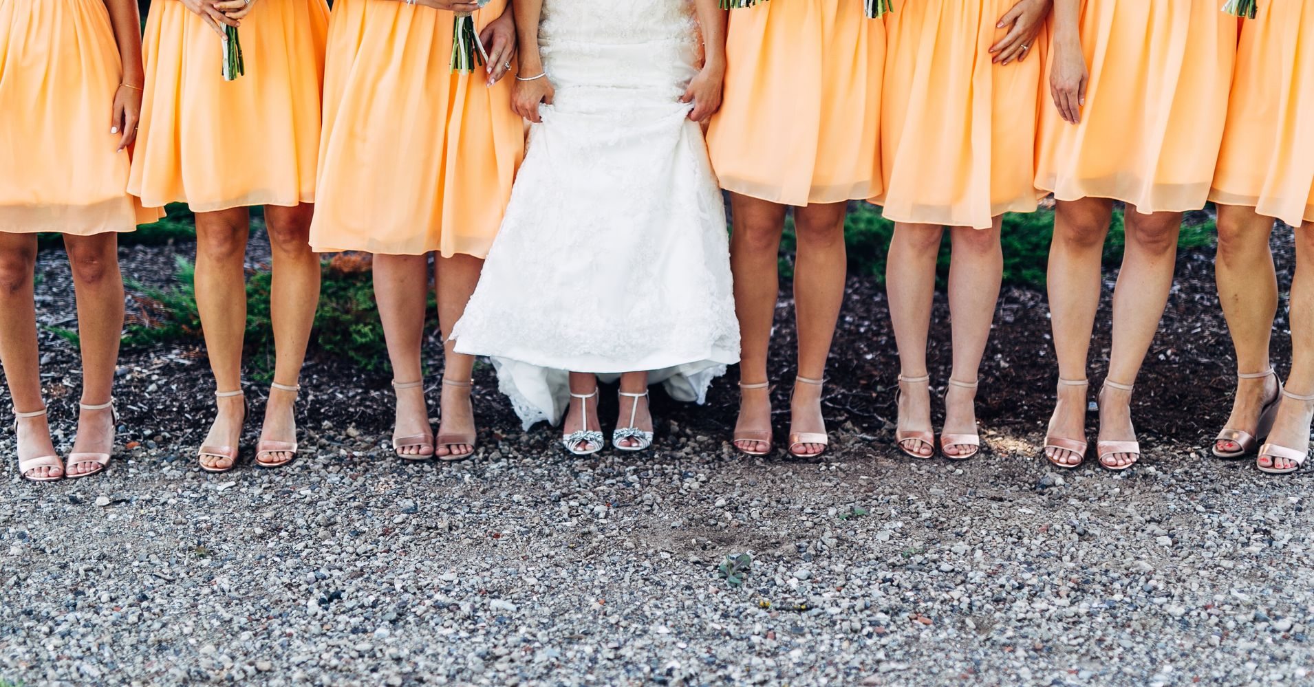Woman Poses With Her 34 Bridesmaids