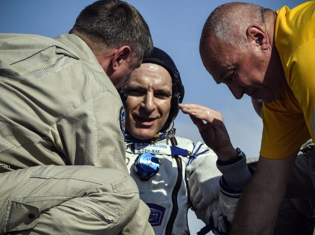 Canadian astronaut David Saint-Jacques is helped by ground personnel in Kazakhstan on Tuesday after returning...