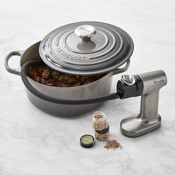 "<a href=""https://www.williams-sonoma.com/products/breville-smoking-gun/?pkey=cbreville-smoking-gun&amp;isx=0.0.369"" target=""_blank"" rel=""noopener noreferrer"">Breville's Smoking Gun</a> imparts smoky flavor to food by ushering smoke into the cooking dish with a hose."