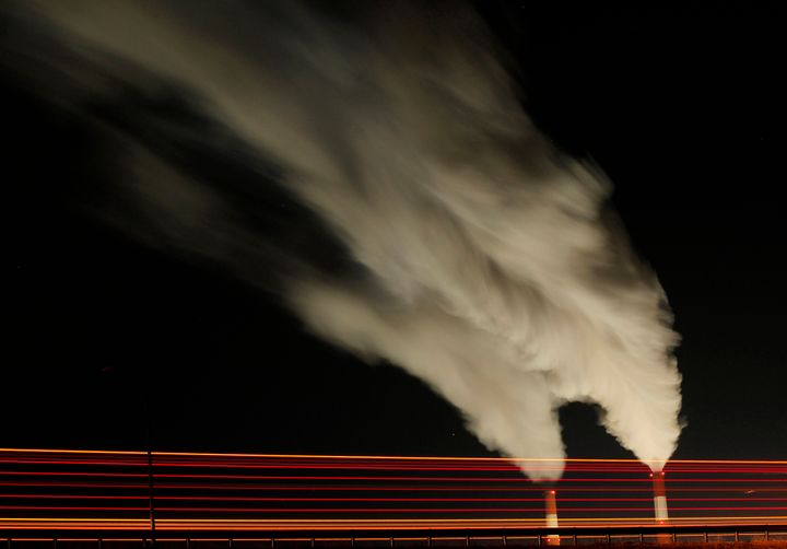 Emissions rise from the stacks of the La Cygne Generating Station coal-fired power plant in La Cygne, Kansas.