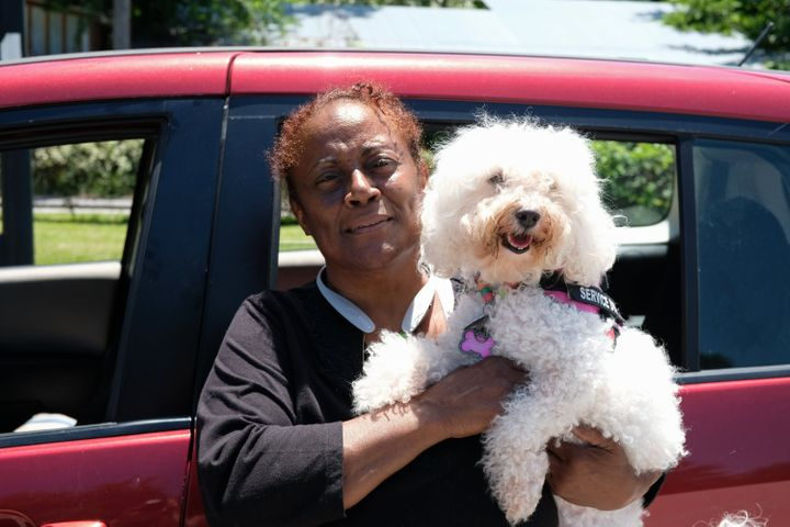 Donna Ware, pictured here with her service dog, Pilaf, is one of the committee's original members and has not had stabl