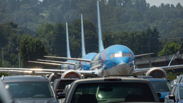 SEATTLE, WA - MAY 31: Boeing 737 MAX airplanes from TUI Airways sit parked in a parking lot at a Boeing facility adjacent to King County International Airport, known as Boeing Field, on May 31, 2019 in Seattle, Washington.  Boeing 737 MAX airplanes have been grounded following two fatal crashes in which 346 passengers and crew were killed in October 2018 and March 2019. (Photo by David Ryder/Getty Images)