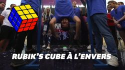 Il résout un Rubik's Cube en 13 secondes la tête à l'envers et bat un record
