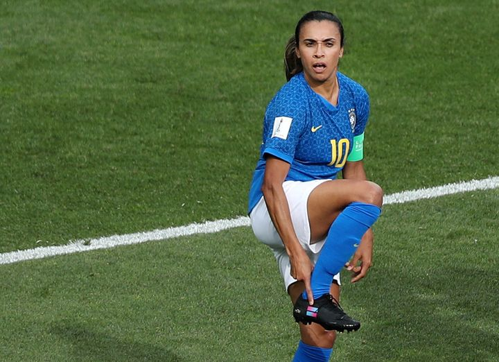 After scoring against Australia, Marta pointed to a women's equality flag on her boot.