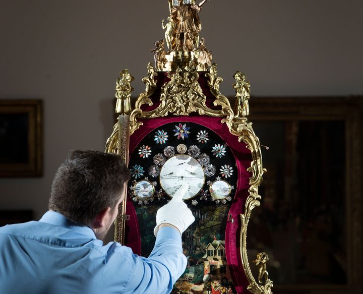 Steve Hearty Wells make adjustments to an ornate eighteenth-century clock at York Art Gallery in the U.K., ahead of daylight saving time.