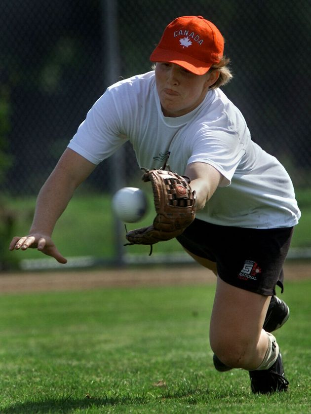 A young Hayley Wickenheiser fields a ball for Team Canada in