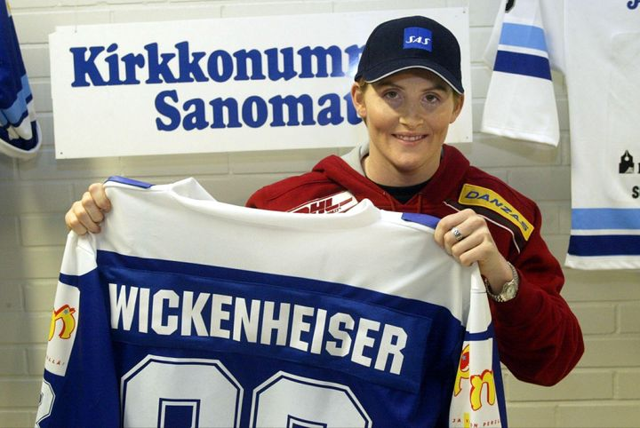 Hayley Wickenheiser holds up her jersey Kirkkonummen Salamat in 2003.
