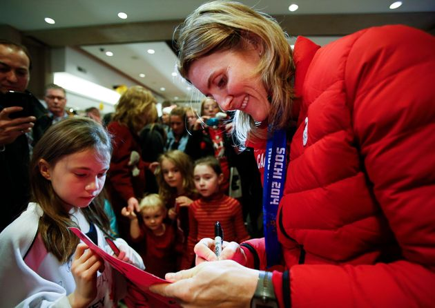 Hayley Wickenheiser signs autographs after returning from the 2014 Sochi