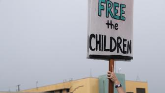 Protestors stand outside of the Homestead Temporary Shelter for Unaccompanied Children, Sunday, June 16, 2019, in Homestead, Fla. A coalition of religious groups and immigrant advocates said they want the Homestead detention center closed. (AP Photo/Lynne Sladky)