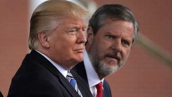 LYNCHBURG, VA - MAY 13:  U.S. President Donald Trump (L) and Jerry Falwell (R), President of Liberty University, on stage during a commencement at Liberty University May 13, 2017 in Lynchburg, Virginia. President Trump is the first sitting president to speak at Liberty's commencement since George H.W. Bush spoke in 1990.  (Photo by Alex Wong/Getty Images)