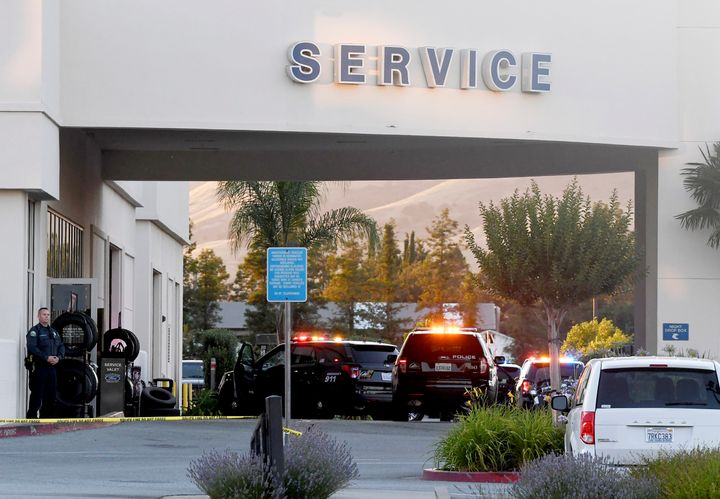 Police investigate at the scene of a shooting at the Morgan Hill Ford Store in Morgan Hill, Calif., on Tuesday.