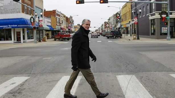 Attorney Thomas Maul crosses 13th Street in downtown Columbus, Nebraska. Maul headed the Nebraska State Bar Association in 20