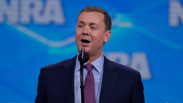 NRA-ILA Executive Director Chris W. Cox speaks at the Nation Rifle Association Institute for Legislative Action Leadership Forum in Lucas Oil Stadium in Indianapolis, Friday, April 26, 2019. (AP Photo/Michael Conroy)