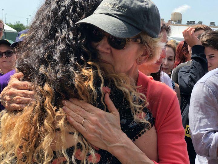 Sen. Elizabeth Warren hugs a crying demonstrator outside the Homestead detention center in Florida on Monday, June 26, 2019.