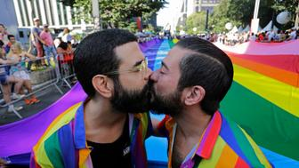 Revelers kiss during the annual gay pride parade along Paulista avenue in Sao Paulo, Brazil, Sunday, June 23, 2019. (AP Photo/Nelson Antoine)