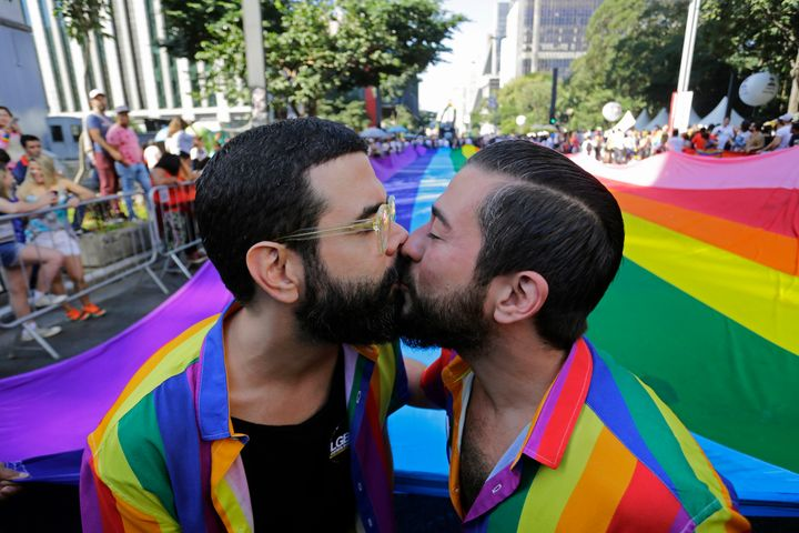 "Two partners kiss during the Pride parade in São Paulo, which acted as a ""confrontation with the policies"" of right-wi"