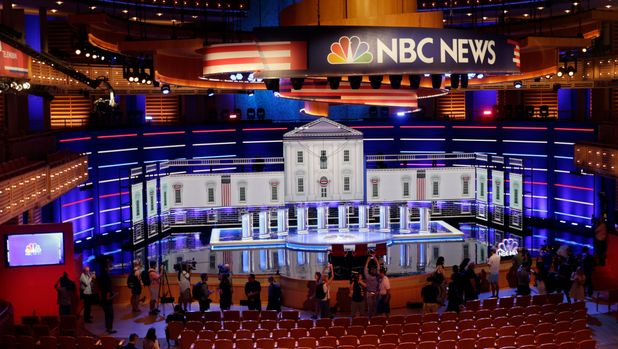 Members of the media gather for a walk-through of the stage set-up for the first democratic debate, Wednesday, June 26, 2019. Ten presidential candidates, led by Sen. Elizabeth Warren, are set to converge on the debate stage on the first night of Democratic debates to offer their pitches to the American people and attempt a breakout moment for their campaigns. (AP Photo/Marta Lavandier)