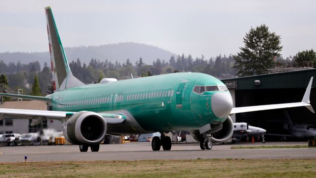 FILE - In this May 8, 2019, file photo a Boeing 737 MAX 8, being built for American Airlines, makes a turn on the runway as it is readied for takeoff on a test flight in Renton, Wash. American Airlines is now removing the Boeing 737 Max from its schedule into early September, about two weeks longer than before.  (AP Photo/Elaine Thompson, File)