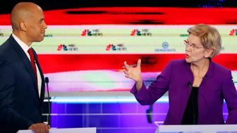 Democratic presidential candidate Sen. Elizabeth Warren, D-Mass., gestures towards New Jersey Sen. Cory Booker, during a Democratic primary debate hosted by NBC News at the Adrienne Arsht Center for the Performing Arts, Wednesday, June 26, 2019, in Miami. (AP Photo/Wilfredo Lee)