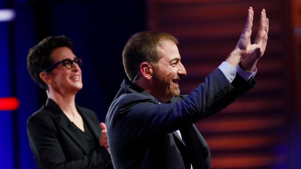 Chuck Todd, NBC News Political Director, and Rachel Maddow, MSNBC host, call for a pause during a Democratic primary debate hosted by NBC News at the Adrienne Arsht Center for the Performing Art, Wednesday, June 26, 2019, in Miami. (AP Photo/Wilfredo Lee)