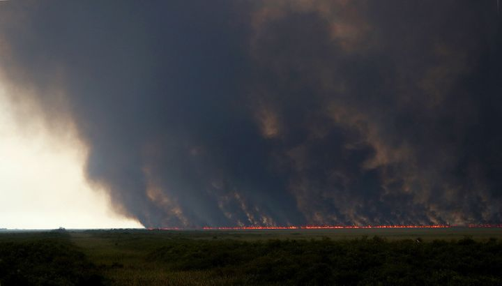 Smoke from a wildfire scorching tens of thousands of acres of the Everglades this week.