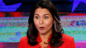 Democratic presidential candidate Rep. Tulsi Gabbard, D-Hawaii, gestures during a Democratic primary debate hosted by NBC News at the Adrienne Arsht Center for the Performing Arts, Wednesday, June 26, 2019, in Miami. (AP Photo/Wilfredo Lee)