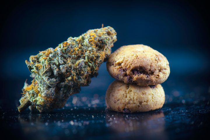 This photo shows cannabis and cannabis-infused chocolate chip cookies.