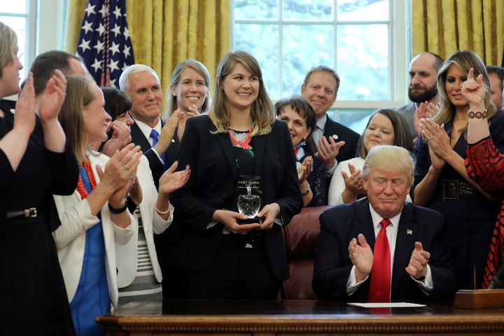 Sydney Chaffee (center) being honored by President Donald Trump after winning the 2017 National Teacher of the Year award.
