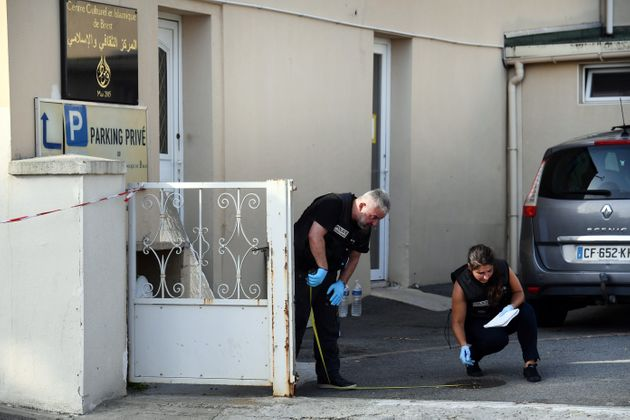 Police officers investigate the site of a shooting incident that left two people injured on June 27,...