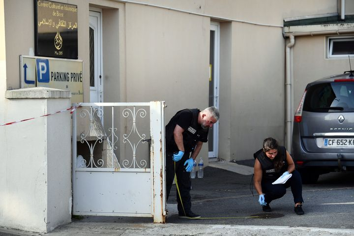 Police officers investigate the site of a shooting incident that left two people injured on June 27, 2019, at the Pontanezen