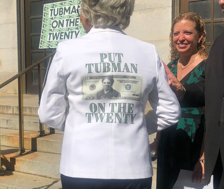 "Rep. Joyce Beatty (D-Ohio) turns around to display the back of her suit jacket that says: ""Put Tubman On The Twenty"" with a m"