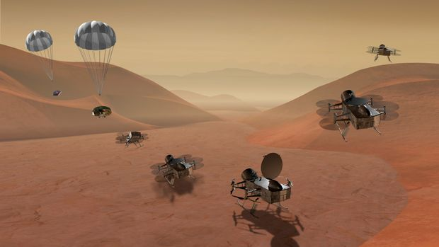 This artist's rendering made available by NASA shows multiple views of the Dragonfly dual-quadcopter lander that would take advantage of the atmosphere on Saturn's moon Titan to explore multiple locations, some hundreds of miles apart. On Thursday, June 2u7, 2019, NASA announced it would send the drone to the jovian planet's largest moon. Scientists have long considered Titan an attractive place to study whether it would be capable of supporting microbial life. (NASA via AP)