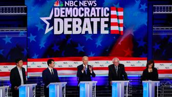 Democratic presidential candidate former vice president Joe Biden, center, speaks during the Democratic primary debate hosted by NBC News at the Adrienne Arsht Center for the Performing Art, Thursday, June 27, 2019, in Miami, as from left, entrepreneur Andrew Yang, South Bend Mayor Pete Buttigieg, fSen. Bernie Sanders, I-Vt., and Sen. Kamala Harris, D-Calif., listen. (AP Photo/Wilfredo Lee)