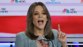 MIAMI, FLORIDA - JUNE 27: Marianne Williamson speaks as former Colorado governor John Hickenlooper looks on during the second night of the first Democratic presidential debate on June 27, 2019 in Miami, Florida.  A field of 20 Democratic presidential candidates was split into two groups of 10 for the first debate of the 2020 election, taking place over two nights at Knight Concert Hall of the Adrienne Arsht Center for the Performing Arts of Miami-Dade County, hosted by NBC News, MSNBC, and Telemundo. (Photo by Drew Angerer/Getty Images)