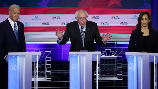 MIAMI, FLORIDA - JUNE 27: Democratic presidential candidates (L-R) former Vice President Joe Biden, Sen. Bernie Sanders (I-VT) and Sen. Kamala Harris (D-CA) take part in the second night of the first Democratic presidential debate on June 27, 2019 in Miami, Florida.  A field of 20 Democratic presidential candidates was split into two groups of 10 for the first debate of the 2020 election, taking place over two nights at Knight Concert Hall of the Adrienne Arsht Center for the Performing Arts of Miami-Dade County, hosted by NBC News, MSNBC, and Telemundo. (Photo by Drew Angerer/Getty Images)