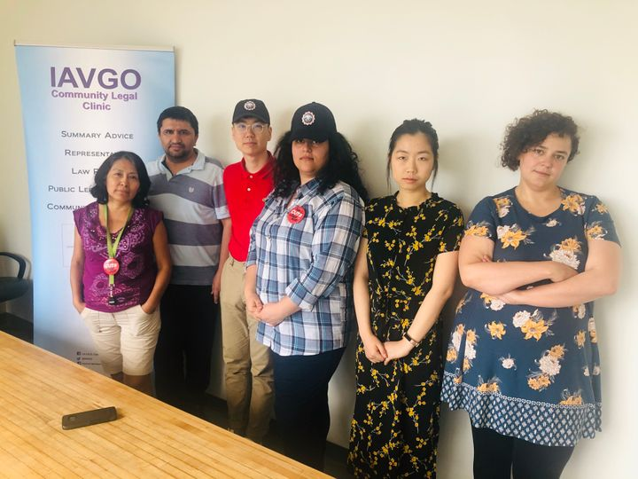 Employees at the Industrial Accident Victims Group of Ontario are taking a pay cut in an attempt to avoid layoffs. Staff Belia Berrocal and Sharif Mahboob, left, and Jenna Meguid, on the right, pose with law students Daniel Yang, Farnaz Talebpour and Linda Yang on June 28, 2019.