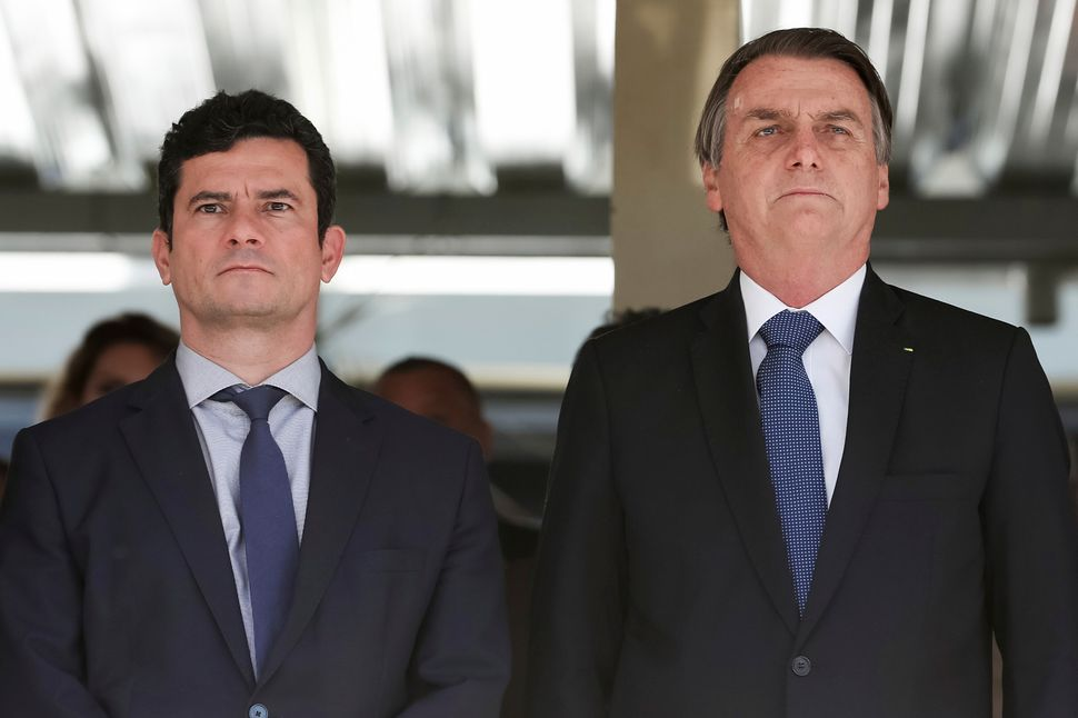 In this photo released by Brazil's Presidential Press Office, President Jair Bolsonaro, right, and Justice...