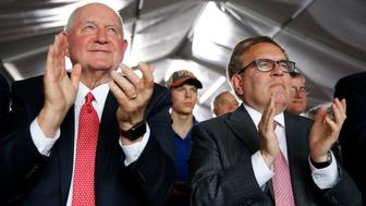 Agriculture Secretary Sonny Perdue, left, and Environmental Protection Agency Administrator Andrew Wheeler applaud as they listen to President Donald Trump speak at Southwest Iowa Renewable Energy in Council Bluffs, Iowa, Tuesday, June 11, 2019. (AP Photo/Patrick Semansky)