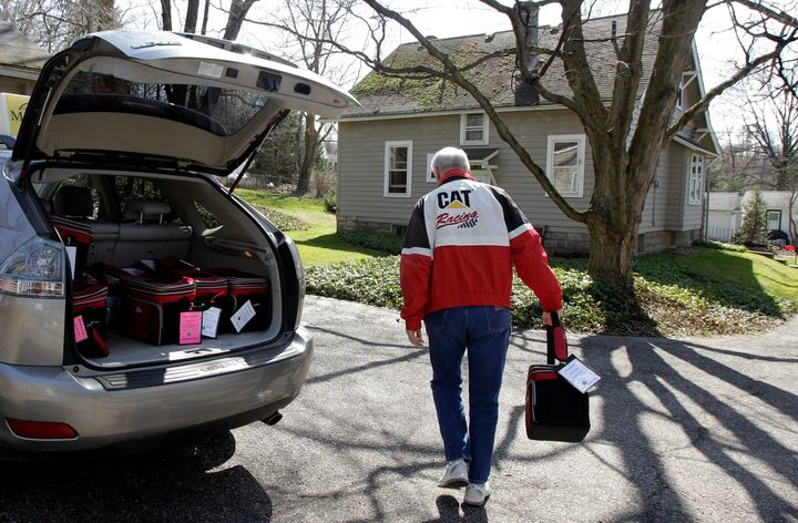 A Meals on Wheels volunteer delivers food to an elderly resident in Chagrin Falls, Ohio.