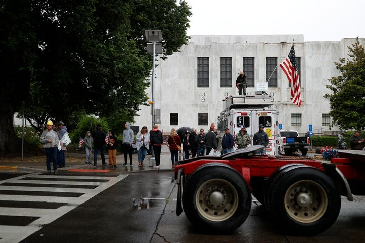 Truckers and loggers opposed to the carbon capping bill hold a rally at the Oregon Capitol on Thursday morning.