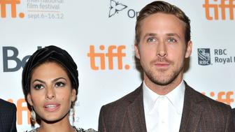 """TORONTO, ON - SEPTEMBER 07:  Actors (L-R) Eva Mendes and Ryan Gosling attend """"The Place Beyond The Pines"""" premiere during the 2012 Toronto International Film Festival at Princess of Wales Theatre on September 7, 2012 in Toronto, Canada.  (Photo by Sonia Recchia/Getty Images)"""
