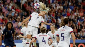 United States' Julie Ertz leaps to head the ball during the Women's World Cup quarterfinal soccer match between France and the United States at Parc des Princes in Paris, France, Friday, June 28, 2019. (AP Photo/Alessandra Tarantino)