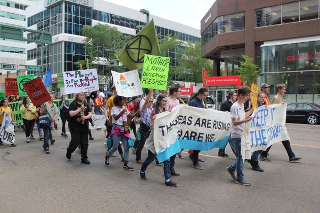 Protesters march through downtown Edmonton as part of the Student Climate March on June 28,