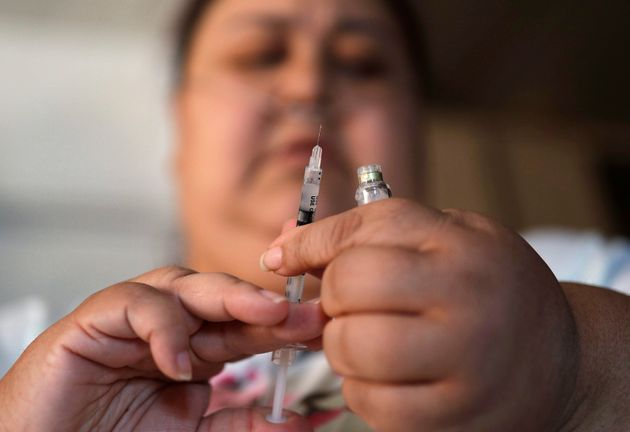 Soila Solano prepares to inject herself withinsulinat her home in Las Vegas on April 18,