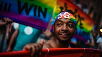 A man attends the Stonewall 50 Pride Rally, Friday, June 28, 2019, in New York. Thousands of people have converged on New York City's Stonewall Inn for the 50th anniversary of the rebellion that catalyzed a movement for LGBTQ liberation. (AP Photo/Eduardo Munoz Alvarez)