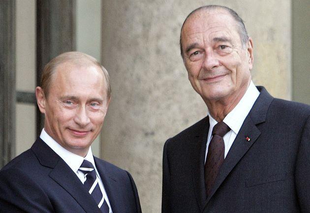 Vladimir Poutine et Jacques Chirac en septembre 2006 devant