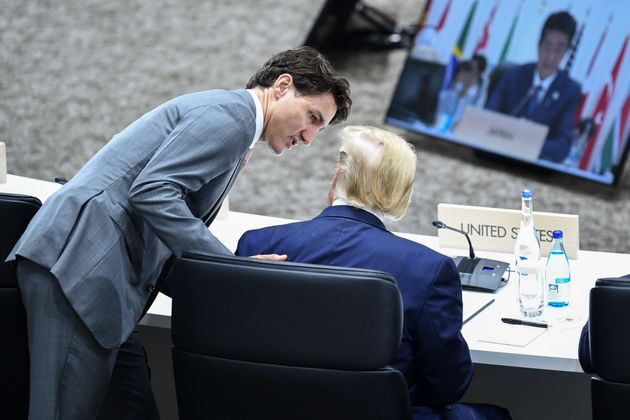 Prime Minister Justin Trudeau speaks with US President Donald Trump during the G20 Summit in Osaka on...