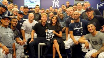 LONDON, ENGLAND - JUNE 29:  Prince Harry, Duke of Sussex and Meghan, Duchess of Sussex pose for a photo with the New York Yankees in the clubhouse prior to game one of the London Series between the New York Yankees and the Boston Red Sox at London Stadium on Saturday, June 29, 2019 in London, England. (Photo by Alex Trautwig/MLB Photos via Getty Images)